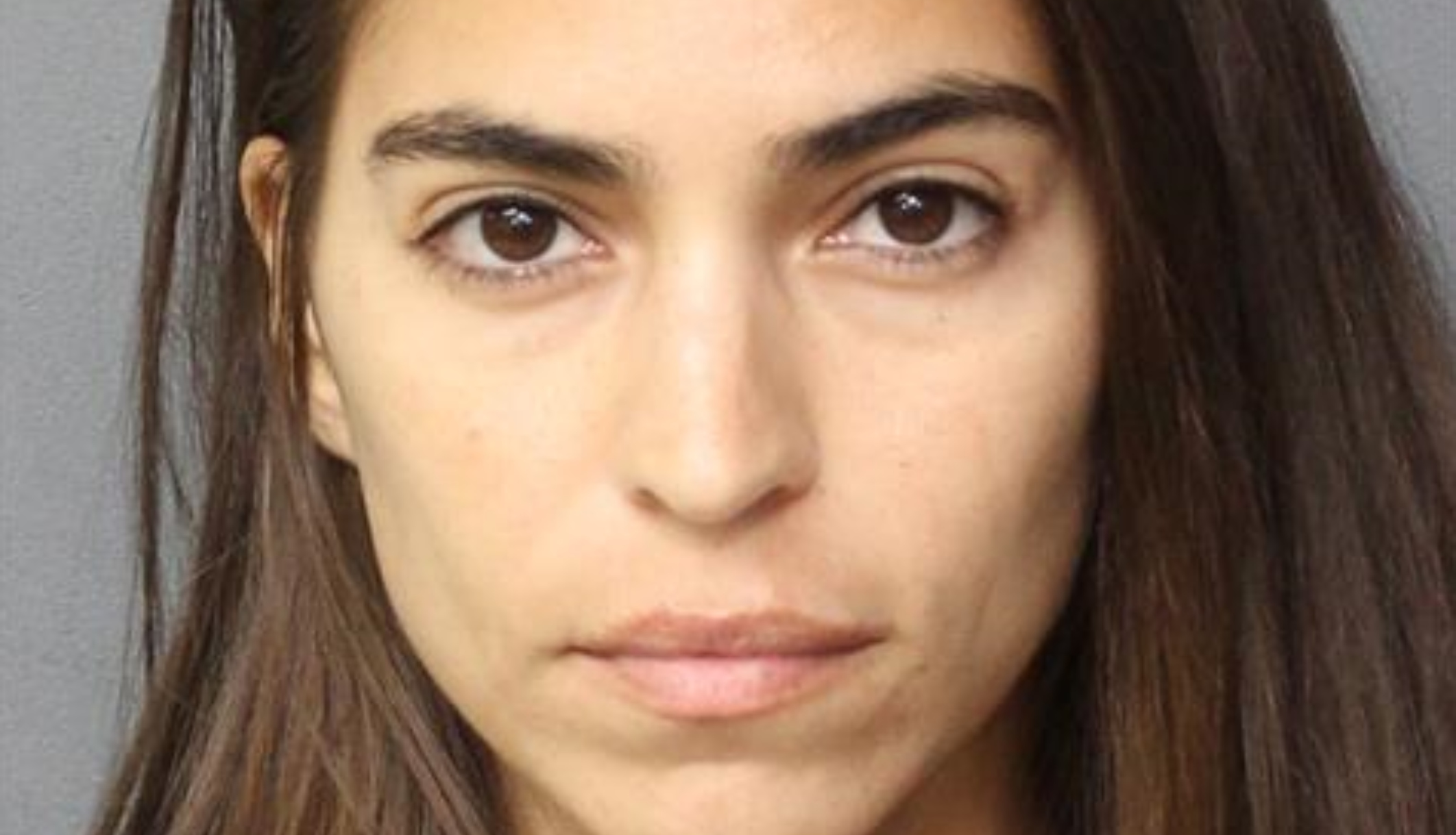 Antonella Barba, of 'American Idol' fame, stands for a booking photo