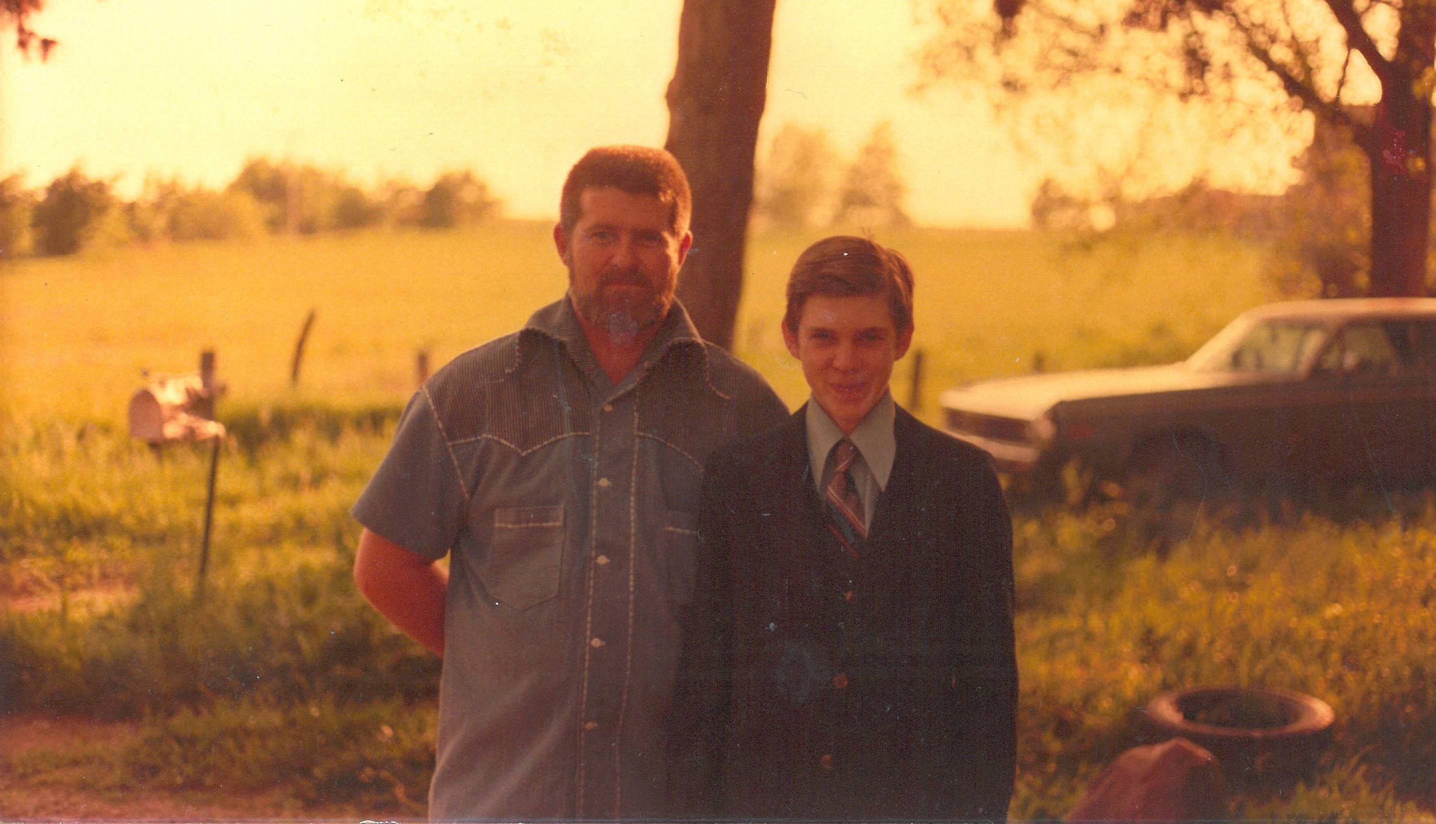 Michael Ryan And Son Dennis Stand In the Sunlight