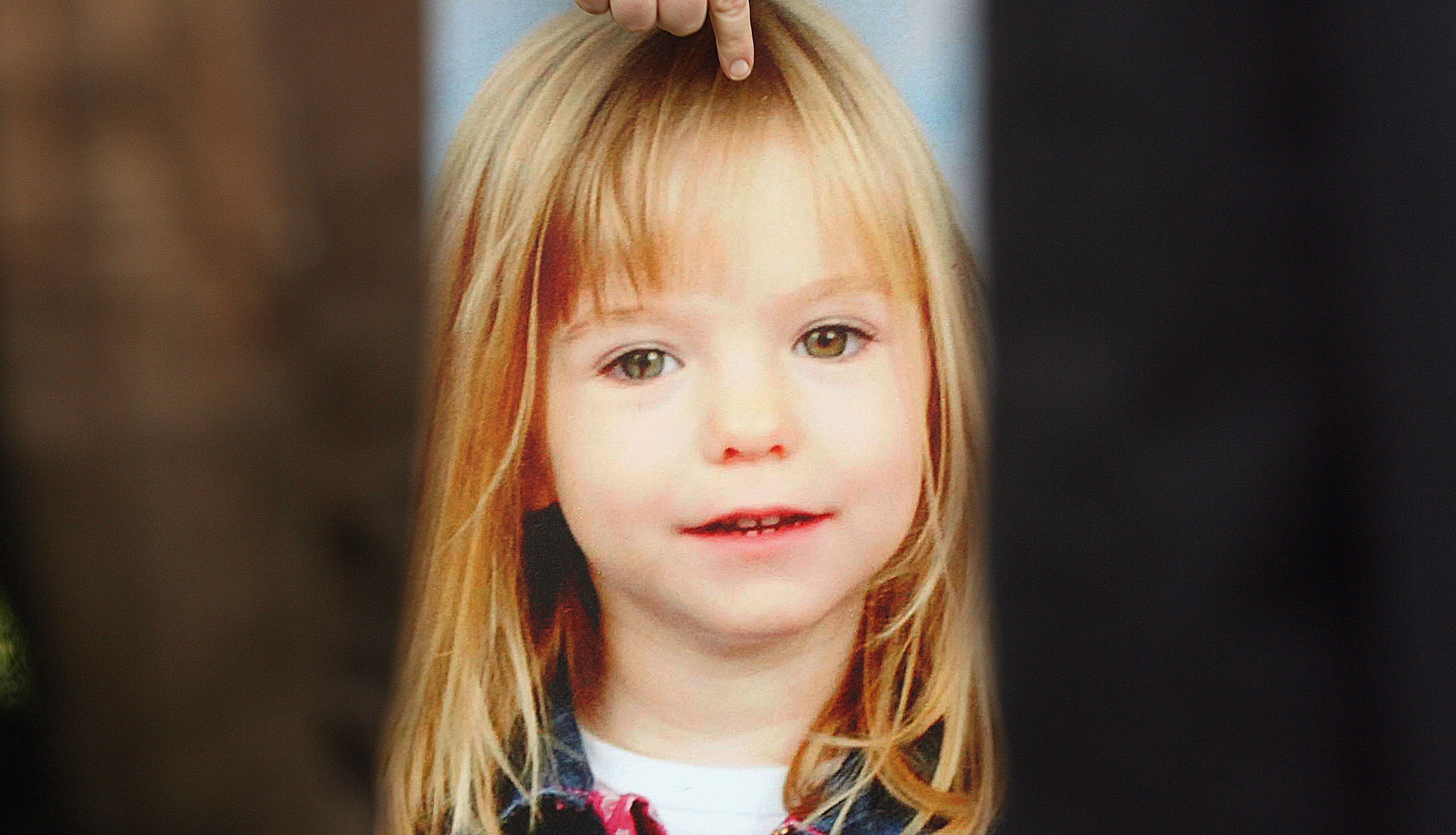 Photo of missing toddler Madeleine McCann is held by her aunt Philomena McCann