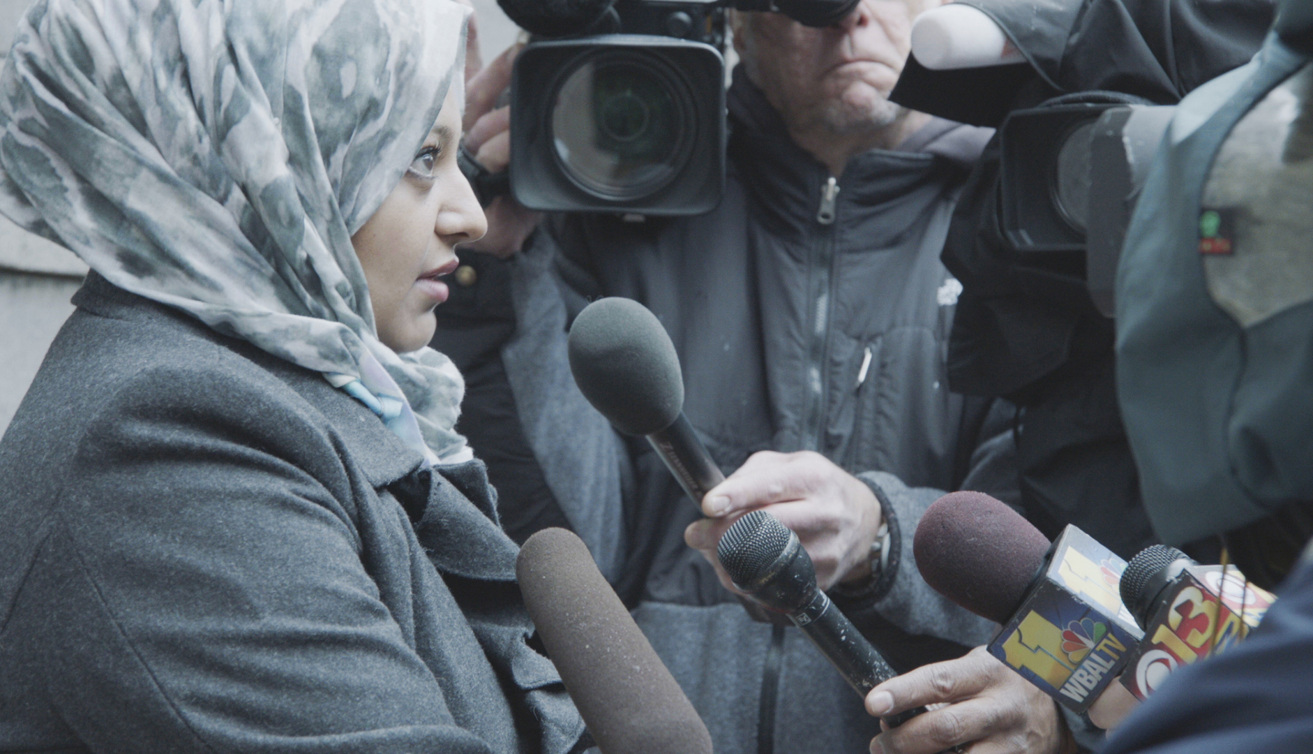 Rabia Chaudry shown talking to reporters.