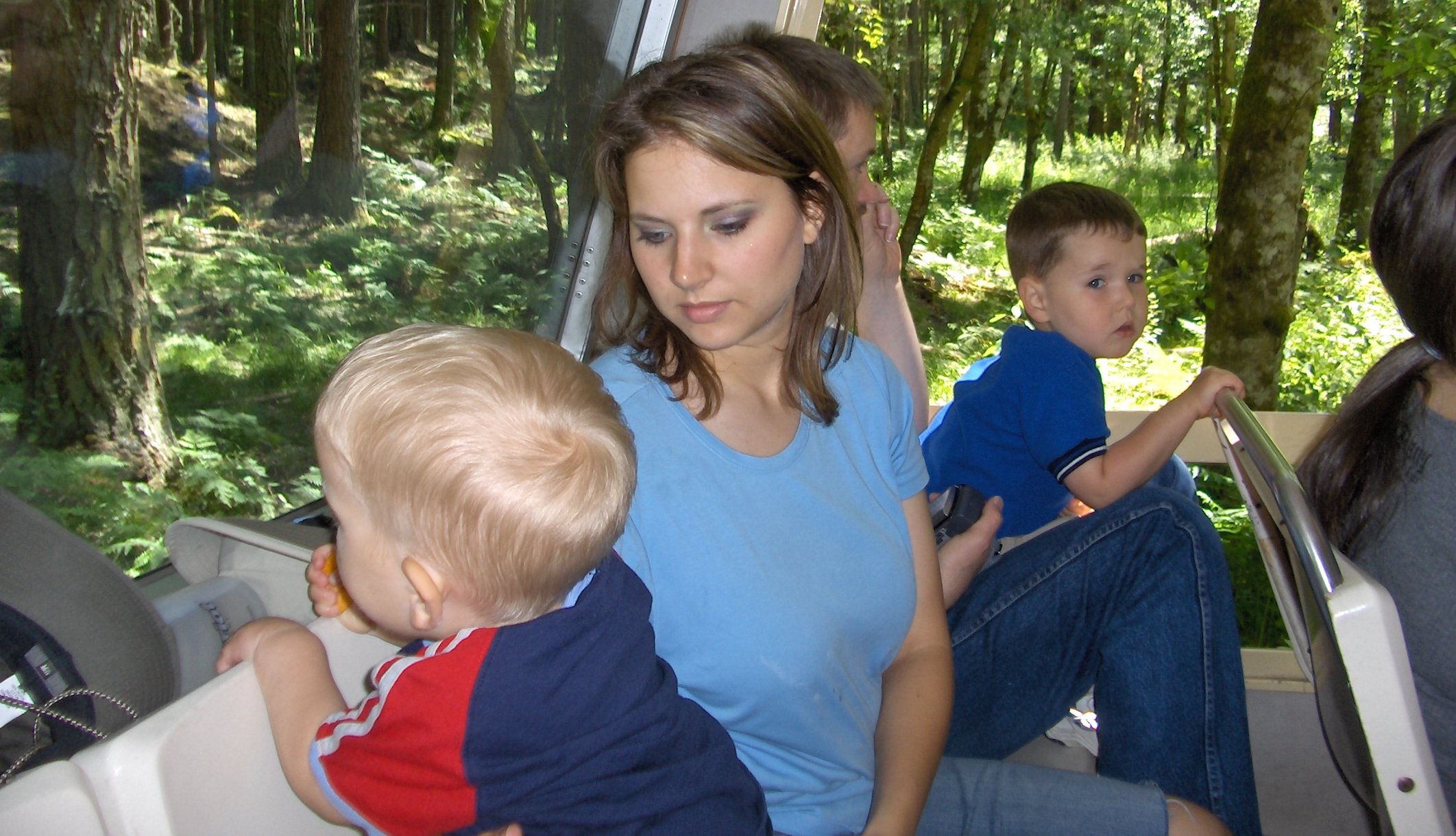 Susan Cox Powell sitting with her two sons, Charlie and Braden, and husband Josh Powell.