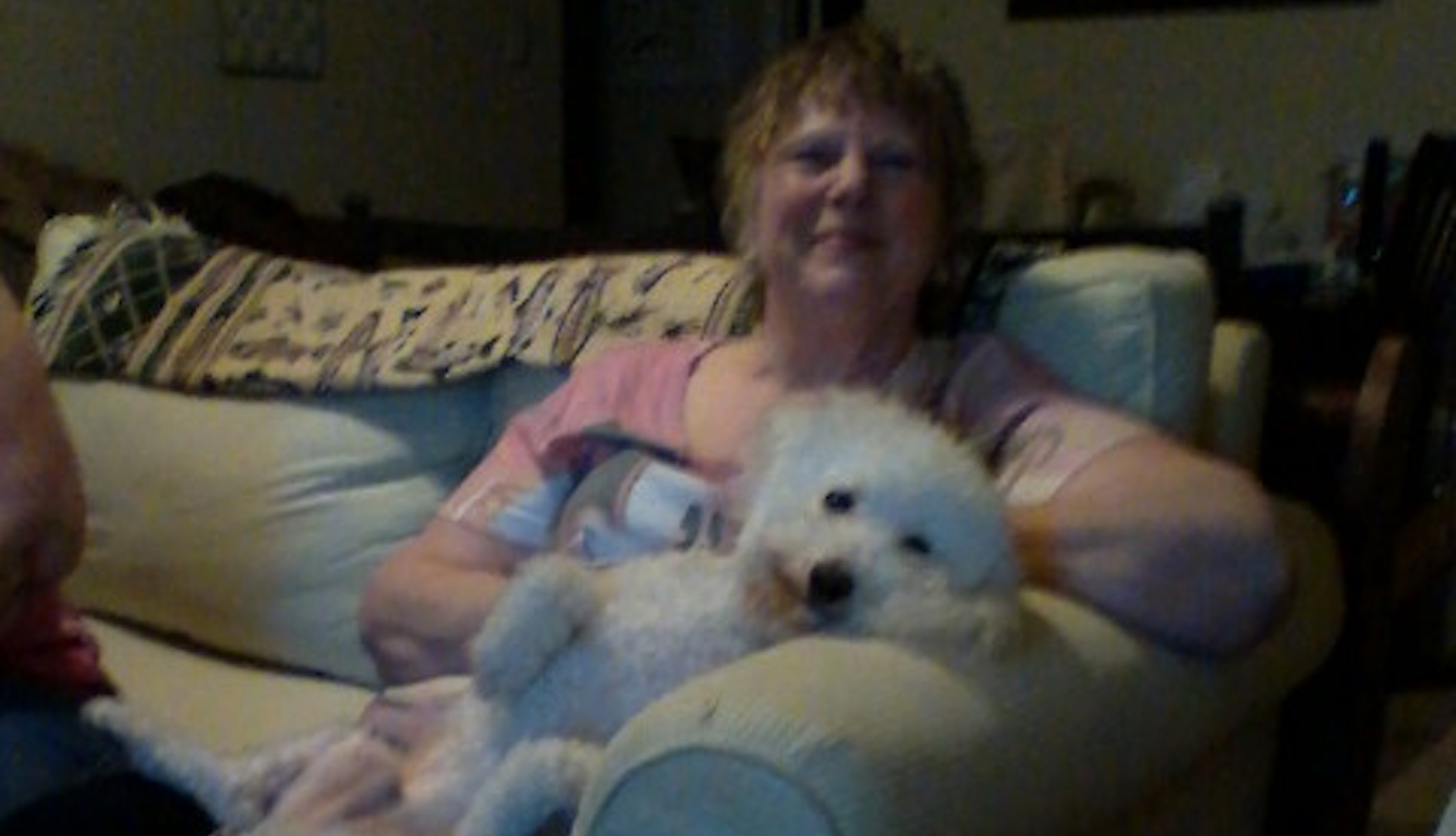 "Jacquaeline ""Jackie"" Z. Williams posing on couch with a dog."