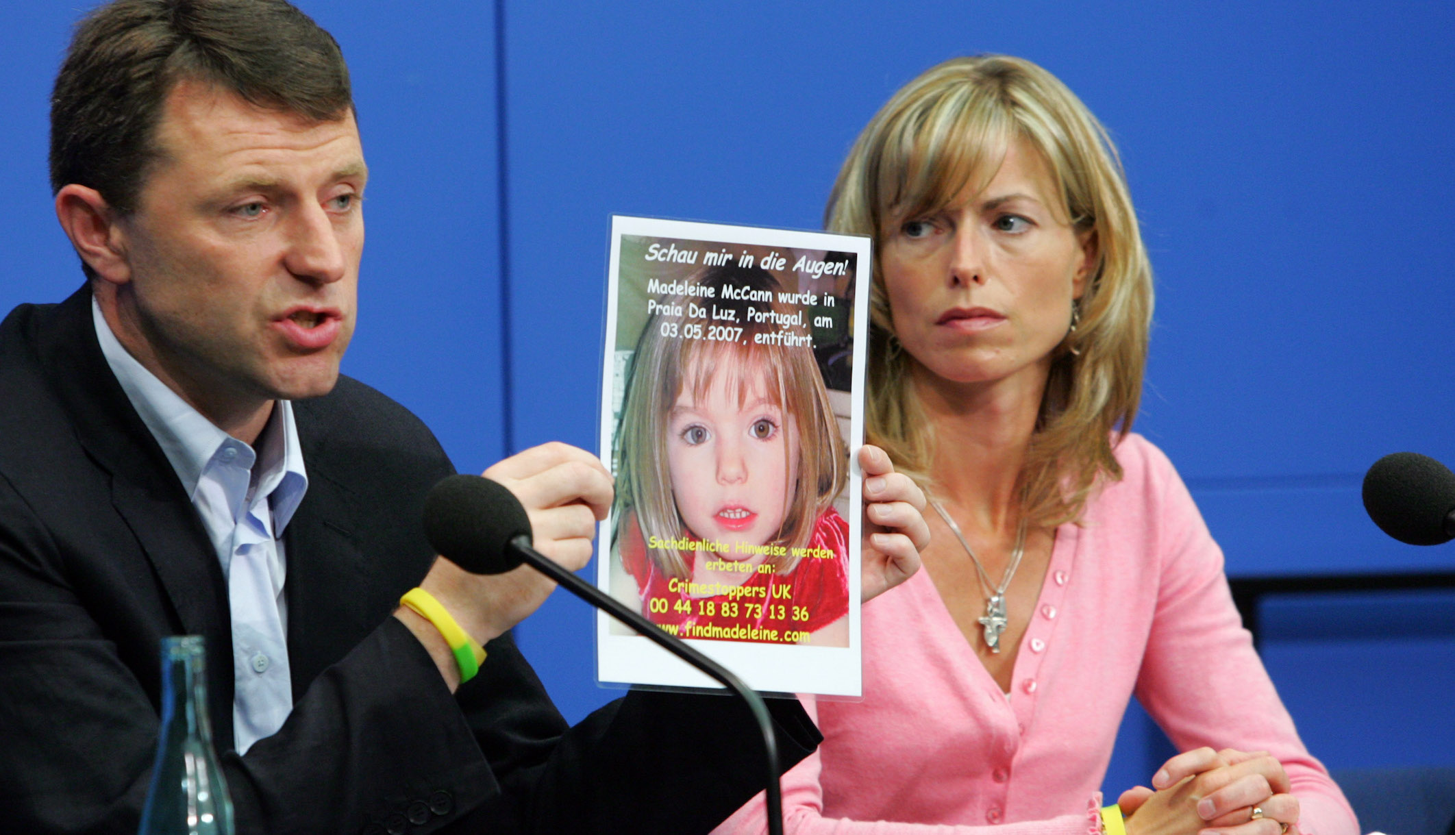 Kate and Gerry McCann, parents of missing 4-year-old British girl Madeleine McCann holding up a picture of their daughter during a press conference.