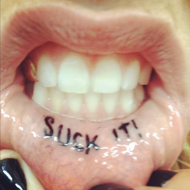 e384f1edf 10 Most Regrettable Celebrity Tattoos | Tattoos After Dark Photos