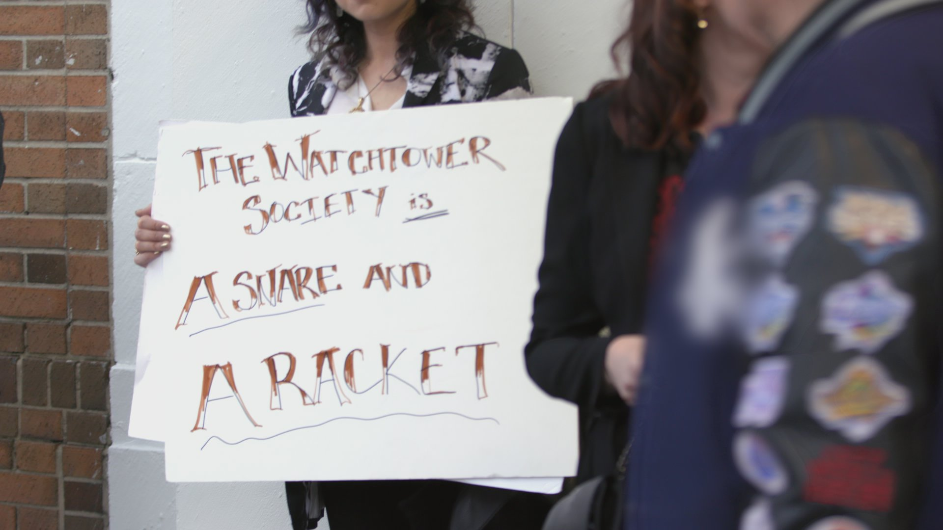 Protest Outside Jehovah's Witnesses Building Prompts Response