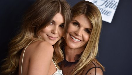 Actress Lori Loughlin (R) pictured here with daughter Olivia Jade Giannulli at a gala in February 2018