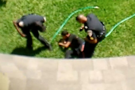 Florida officer shoves teen from roof as partner shouts, 'Push him off!'