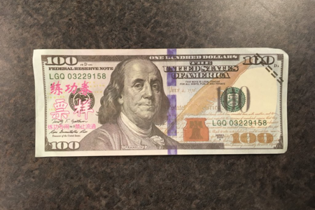 Counterfeit $100 Bills With Chinese Lettering On Them Found