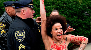 Topless Protester Arrested Outside Bill Cosby Trial Courthouse